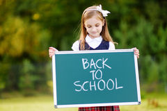 Adorable little girl feeling excited about going back to school Stock Photos