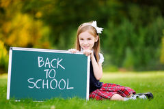 Adorable little girl feeling excited about going back to school Stock Image