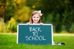Adorable little girl feeling excited about going back to school Stock Photo