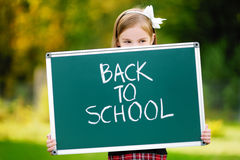 Adorable little girl feeling exited about going back to school Royalty Free Stock Photography