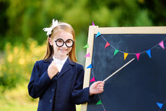 Adorable little girl feeling exited about going back to school Royalty Free Stock Photos