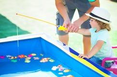 Adorable little girl fishing. royalty free stock photos