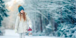 Adorable little girl with flashlight and candle in winter royalty free stock photography