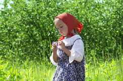Adorable little girl with flower in her hands Royalty Free Stock Photo