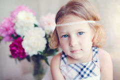 Adorable little girl with flowers Stock Photography