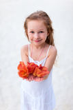 Adorable little girl with flowers Stock Image
