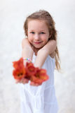 Adorable little girl with flowers Royalty Free Stock Photography