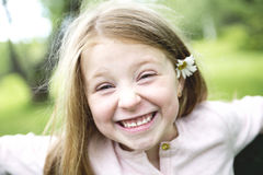 Adorable little girl in the forest meadow Stock Photo