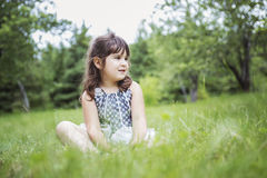 Adorable little girl in the forest meadow Stock Photography