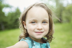 Adorable little girl in the forest meadow Royalty Free Stock Image