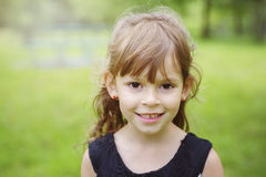 Adorable little girl in the forest meadow Royalty Free Stock Photos