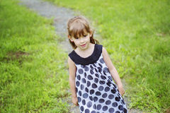 Adorable little girl in the forest meadow Stock Photos