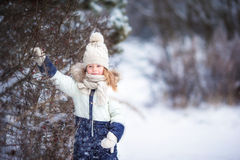 Adorable little girl in frozen winter day outdoors Stock Photography