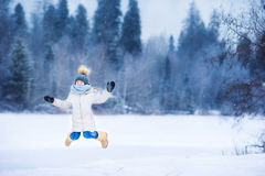 Adorable little girl in frozen winter day outdoors Stock Photo