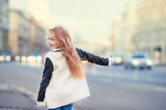 Adorable little girl get taxi outdoors in European Royalty Free Stock Photography