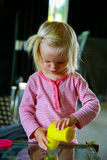 Adorable little girl is getting ready for painting. Royalty Free Stock Photos