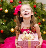 Adorable little girl with gift box Royalty Free Stock Photography