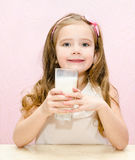 Adorable little girl with glass of milk Stock Image