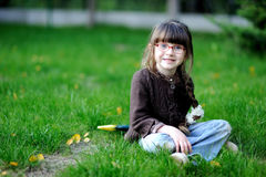 Adorable little girl in glasses and brown sweater Royalty Free Stock Image