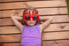 Adorable little girl in glasses with the words Stock Photos