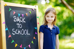 Adorable little girl is going back to school Royalty Free Stock Photography