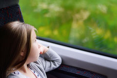 Adorable little girl going on vacations and traveling by railway. Adorable little girl going on vacations and traveling by railway Royalty Free Stock Photography
