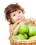 Adorable little girl with green apples basket Royalty Free Stock Photos