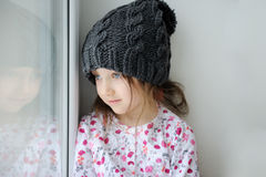 Adorable little girl in grey knit Royalty Free Stock Photos
