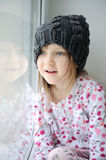 Adorable little girl in grey knit Stock Images