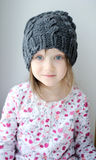 Adorable little girl in grey knit Royalty Free Stock Images