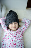 Adorable little girl in grey knit Royalty Free Stock Image