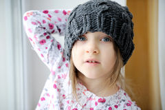 Adorable little girl in grey knit hat Stock Photography