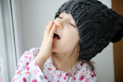 Adorable little girl in grey knit hat Royalty Free Stock Images