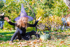 Adorable little girl in Halloween which costume Stock Photos
