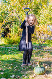 Adorable little girl in halloween witch costume on Royalty Free Stock Photos