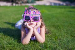 Adorable little girl in Happy Birthday glasses Royalty Free Stock Photography