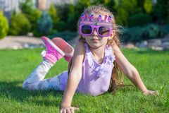 Adorable little girl in Happy Birthday glasses Royalty Free Stock Image