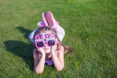 Adorable little girl in Happy Birthday glasses Stock Photos