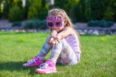 Adorable little girl with Happy Birthday glasses Stock Images