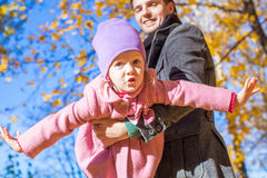 Adorable little girl with happy father having fun Stock Images