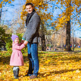 Adorable little girl with happy father in park at Stock Images