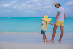 Adorable little girl and happy father on tropical white beach Stock Photos
