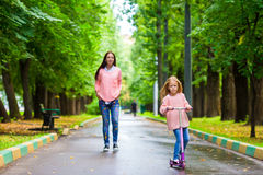 Adorable little girl with happy mom have fun on Royalty Free Stock Photography