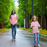Adorable little girl with happy mom have fun on Stock Photography