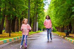 Adorable little girl with happy mom have fun on Royalty Free Stock Images