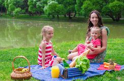 Adorable little girl and happy mother picnicking Stock Photography