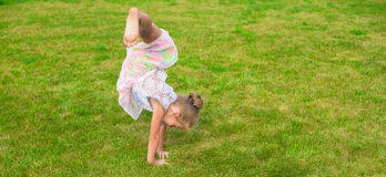 Adorable little girl happy outdoor at summer time Stock Photography