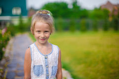 Adorable little girl happy outdoor at summer time Royalty Free Stock Image