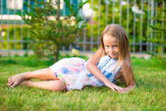 Adorable little girl happy outdoor at summer time Stock Images
