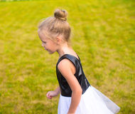 Adorable little girl happy outdoor at summer time Stock Photo